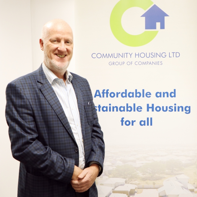 CHL Group Managing Director, Steve Bevington standing in front of CHL Banner